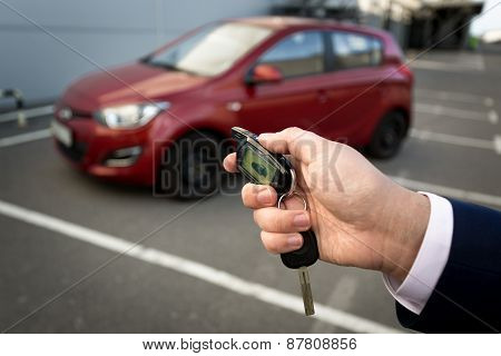 Closeup Photo Of Man Opening Car With Remote Alarm Key