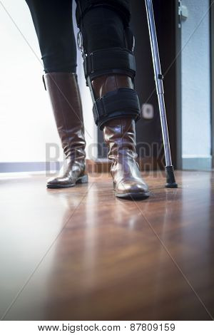 Lady Walking On Crutches In Hospital Clinic
