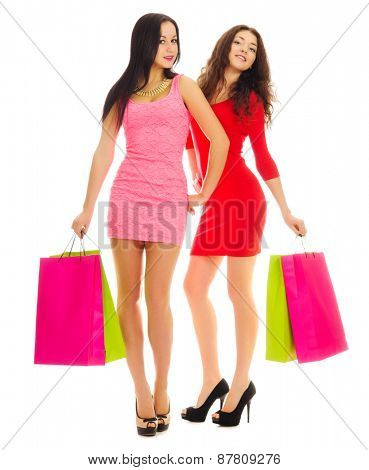 Two young smiling girls with bags isolated
