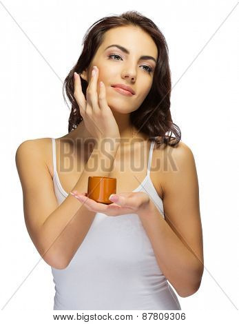 Young girl with body cream isolated