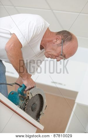 Experienced carpenter using a circular saw