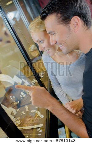 Couple stood outside a jewellery shop