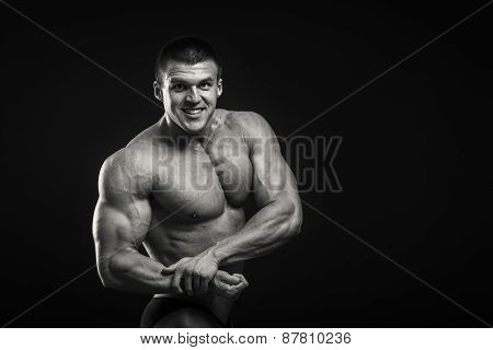 A very strong man on a dark background.