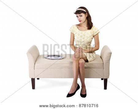 Woman Sitting with an Empty Tray