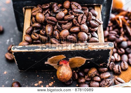 Old wooden box with coffee beans inside