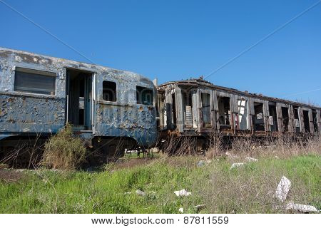 Old Abandoned Trains In Sunny Day