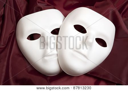 White mask and red silk fabric, isolated on white background