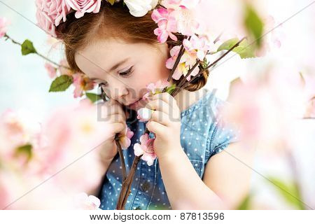 Cute little girl in the flower garden