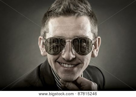 Portrait of contemporary smiling man in glasses
