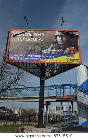 KIEV, UKRAINE - APRIL13, 2015. Ukrainian military propaganda.Poster on billboard.Civil War in Ukraine. April, 2015 Kiev, Ukraine