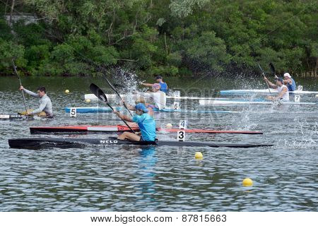 DNEPROPETROVSK, UKRAINE - MAY 29, 2013: Kayak racing during Ukrainian paddling championships. Dnepropetrovsk rowing canal is the main Ukrainian sport arena in kayaking