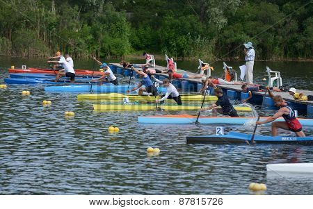 DNEPROPETROVSK, UKRAINE - MAY 29, 2013: Start of canoe racing during Ukrainian paddling championships. Dnepropetrovsk rowing canal is the main Ukrainian sport arena in kayaking