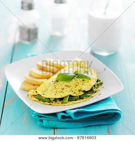 breakfast asparagus omelet on rustic painted planks