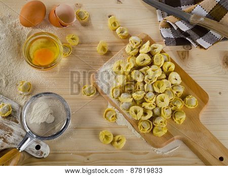 Uncooked Ravioli On A  Wooden Cutting Board.