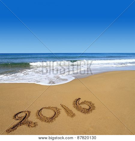 2016 written on sandy beach