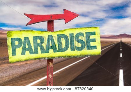 Paradise sign with road background
