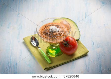 gazpacho with avocado tomato seeds poppy and cream sauce