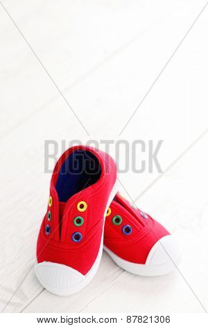 red baby shoes on white - baby stuff