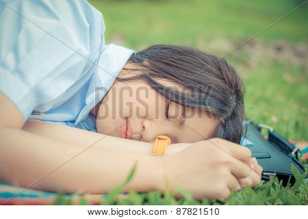 Cute Thai Schoolgirl Fall Asleep During Doing Outdoor Homework In Childhood Theme.