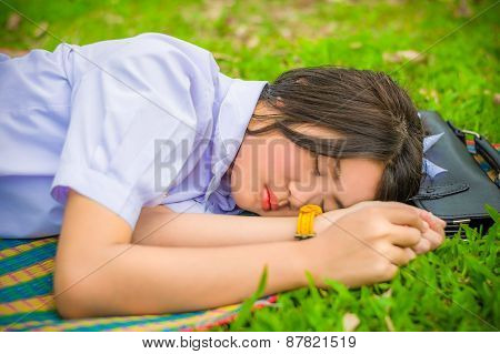 Cute Thai Schoolgirl Fall Asleep On The Mat During Doing Outdoor Homework