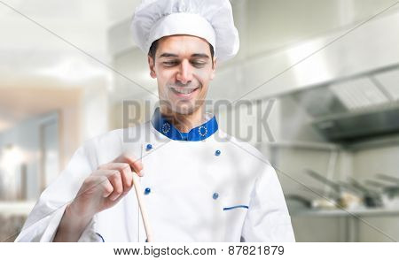 Young chef cooking