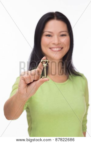 Asian woman hold old key on white