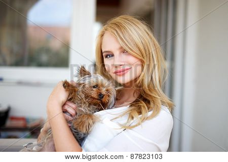 Young Blonde Woman With Little Dog