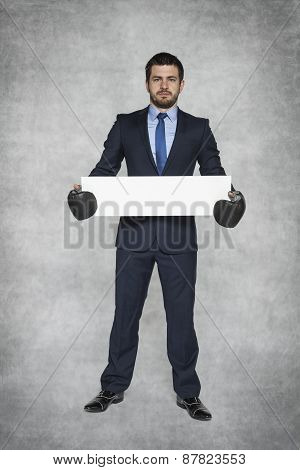 Businessman Holding A Cardboard Box With Space For Advertisement