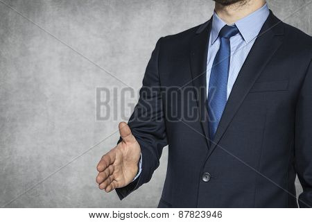 Businessman Holds Out His Hand To Greet