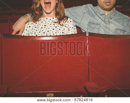 Couple Watching A Film In A Movie Theater