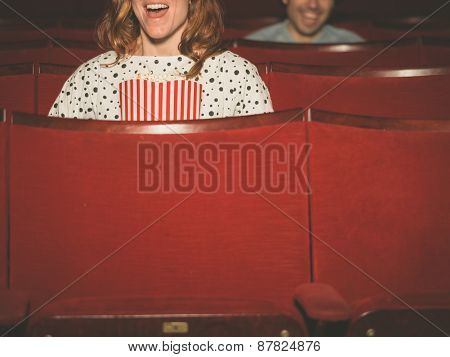 People Watching Film In Movie Theater