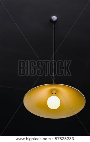 Chandelier With Lamp On A Dark Ceiling.