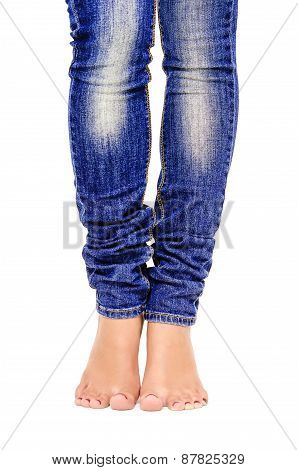 Female feet in jeans