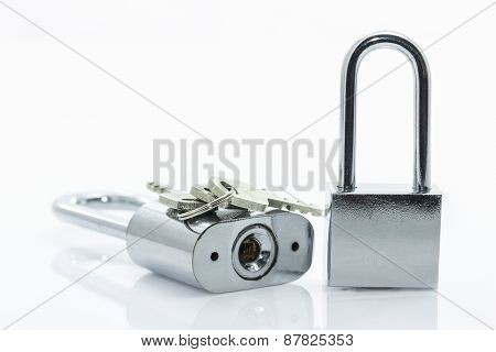 Metallic Padlock With  Keys On White Background