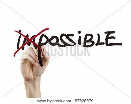 Hand Turning The Word Impossible Into Possible