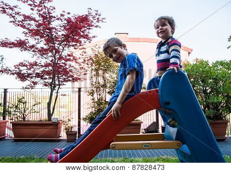 Children And Slide