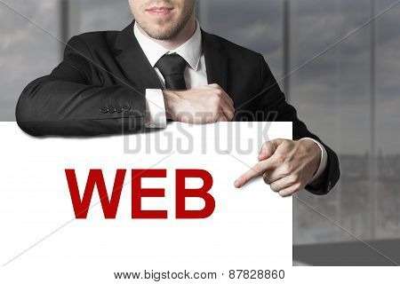 Businessman Pointing On Sign Web
