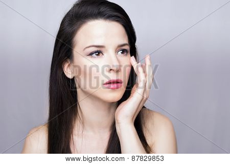 Woman putting on a face cream