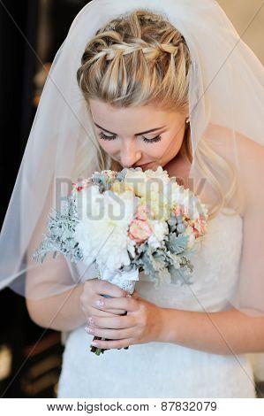 Happy Bride Smelling Bridal Bouquet