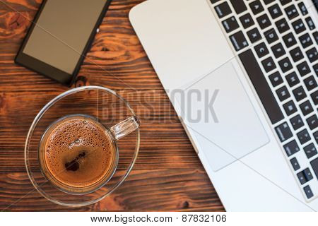 Open Notebook,coffie And Smartphone  Wooden Table, Top View