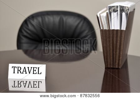 Business card on desk for travel with files vacation get away relax enjoyment planning