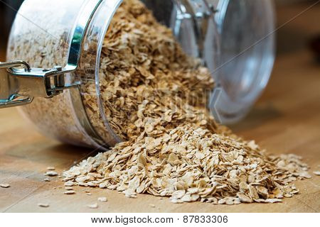 Rolled Oats Falling Out Of A Glass Jar
