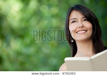 Woman Reading Outdoors