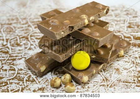 Bunch Of Hazelnut Chocolate On A Table