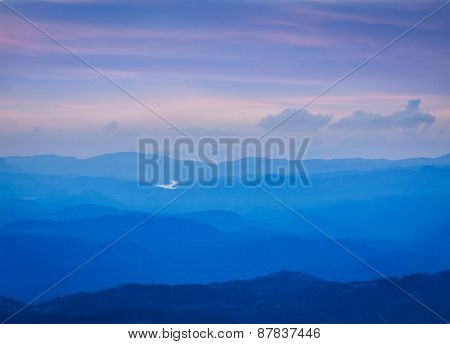 Peaceful sunset landscape in mountains. Kerala, India