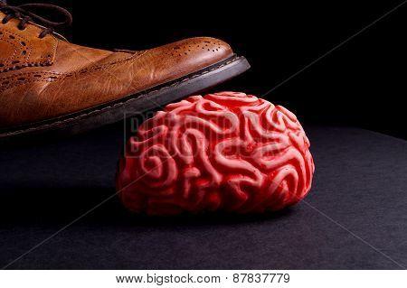 Human Brain Under A Business Man Feet