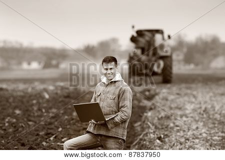 Farmer With Laptop In Field