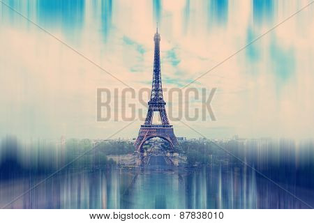 Abstract Background. The Eiffel Tower In Paris - Radial Zoom Blur Effect Defocusing Filter Applied,