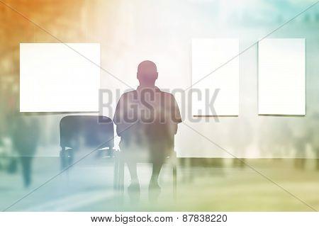 Double Exposure Man Sitting In Art Gallery