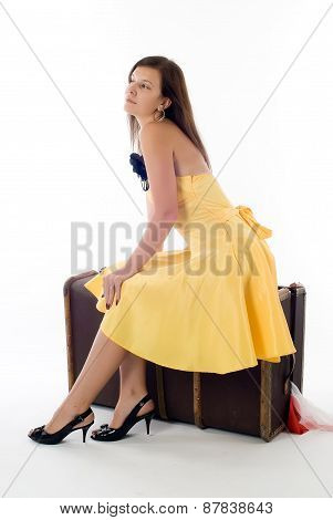 Attractive girl on suitcase